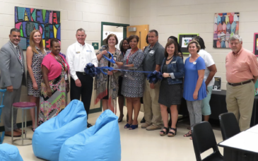 Parent Laundry Center partners, from left: Baldwin County School District Deputy Superintendent Julio Delgado, Milledgeville/Baldwin County Chamber of Commerce CEO Angie Martin, Baldwin Board of Education Board Chair Shannon Hill, Bill Jones of Citizens Bank, Lakeview Academy Principal Shawne Holder, Baldwin County School District Assistant Superintendent of Curriculum and Instruction Sharon Hunt-Simmons, Baldwin County School District Superintendent Noris Price, Baldwin County Schools parent engagement specialist Karen Stanley, Curtis Cox of Pamlico Pools, Lakeview Academy social worker and Baldwin Family Connection Executive Board member Ola Scott-Little, Northridge Christian Church Outreach Pastor Amy Raburn, Baldwin Family Connection Vice Chair Diane Lucette, Baldwin County Family Connection coordinator Janet Cavin, and Baldwin Board of Education member Lyn Chandler  Photo by Byron Wellman, School & Community Relations Coordinator, Baldwin County Schools